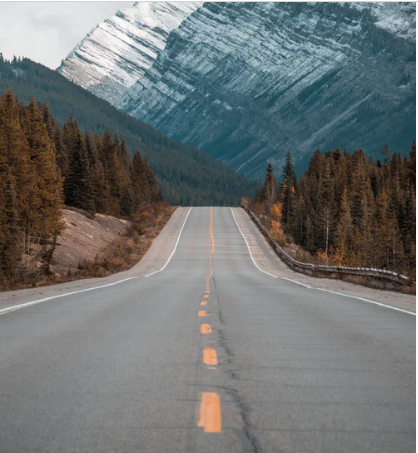 road leading into an unknown mountain